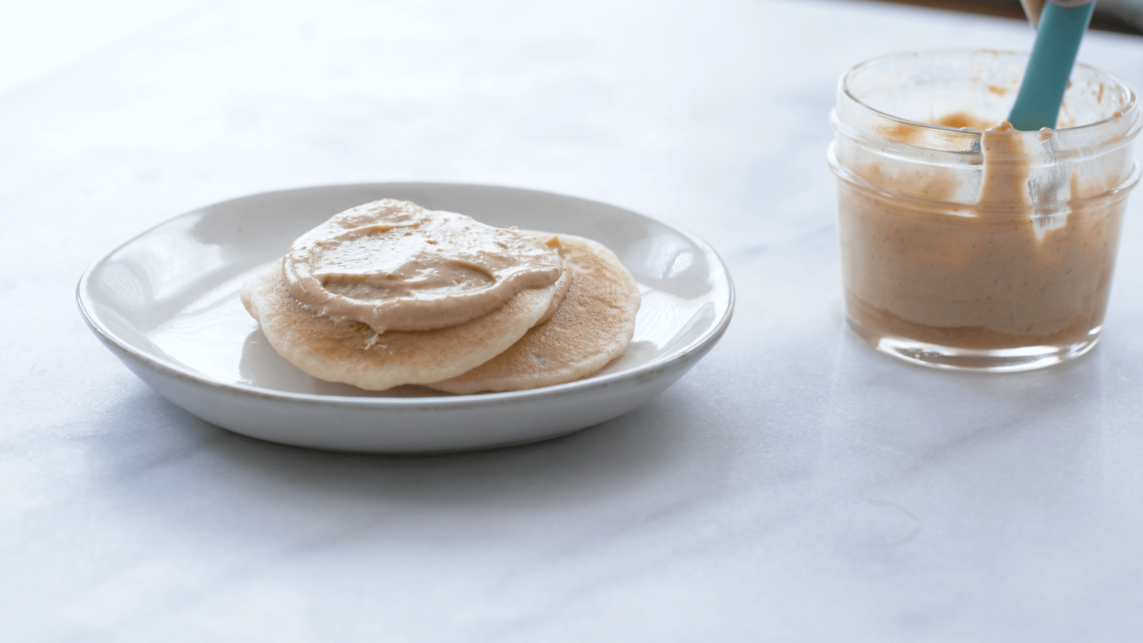 Fluffy PB spread on pancakes-- whip PB with hot water. With the latest research suggesting early peanut introduction, we've rounded up 8 ways on how to feed peanut butter to baby.