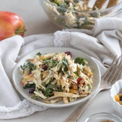 Apple Crunch Slaw with Almond Butter Dressing... yep, let's talk legit fall food over here. We love the crunch in this plant-based salad from all the shredded veggies, apples, and sunflower seeds.