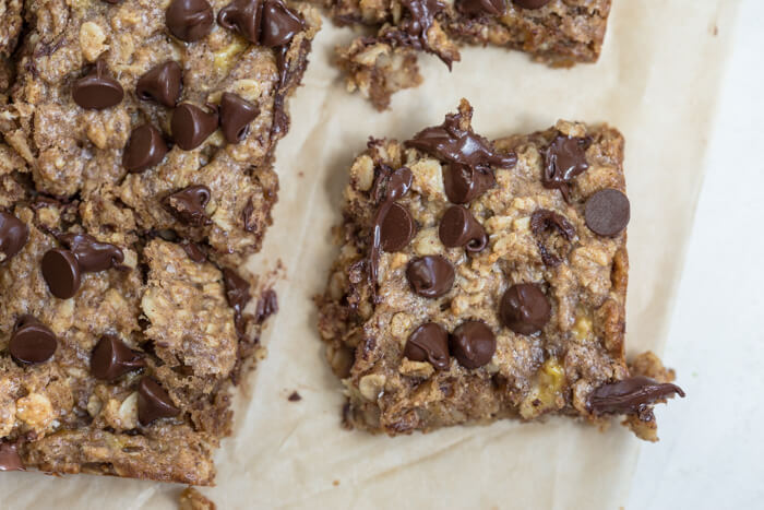 Soft Baked Almond Butter Banana Oat Bars, a whole food bar made in one bowl with simple ingredients. Soft baked and yummy for breakfast, snack or dessert.