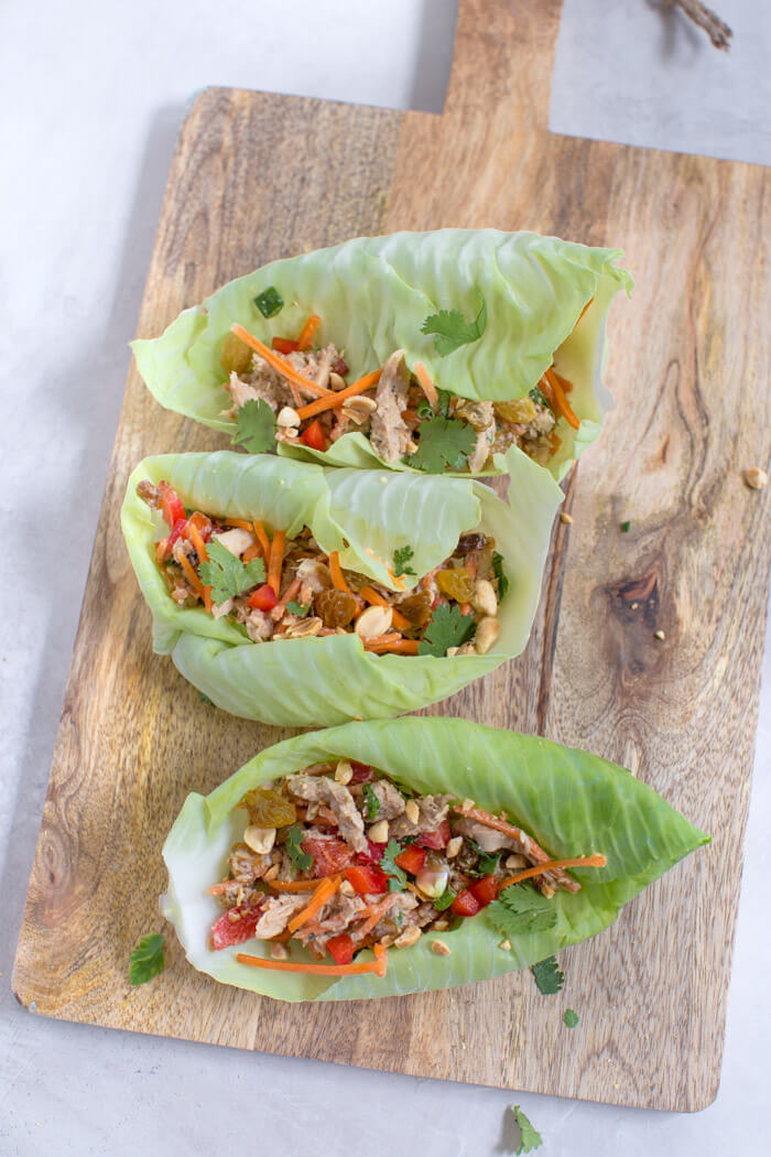 healthy lunch recipe with chicken, carrots, bell peppers, and peanuts