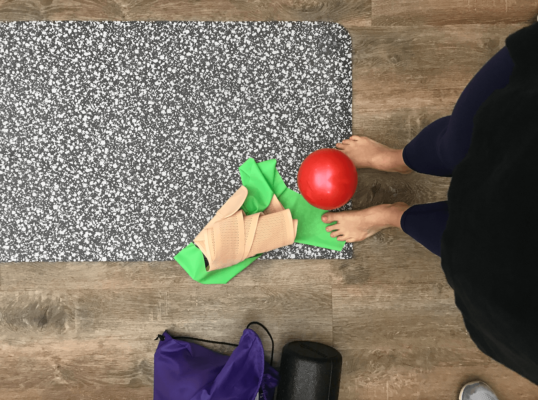 postpartum girdle and exercise ball on yoga mat