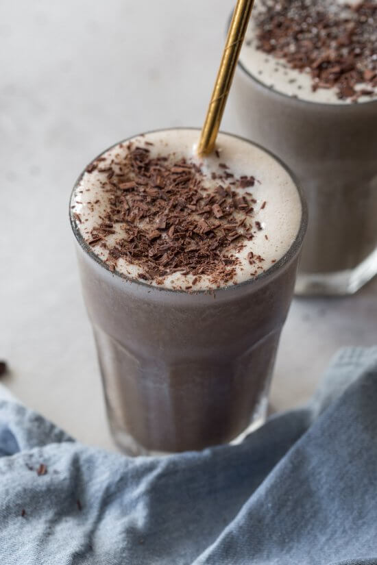 chocolate protein shake with chocolate shavings on top