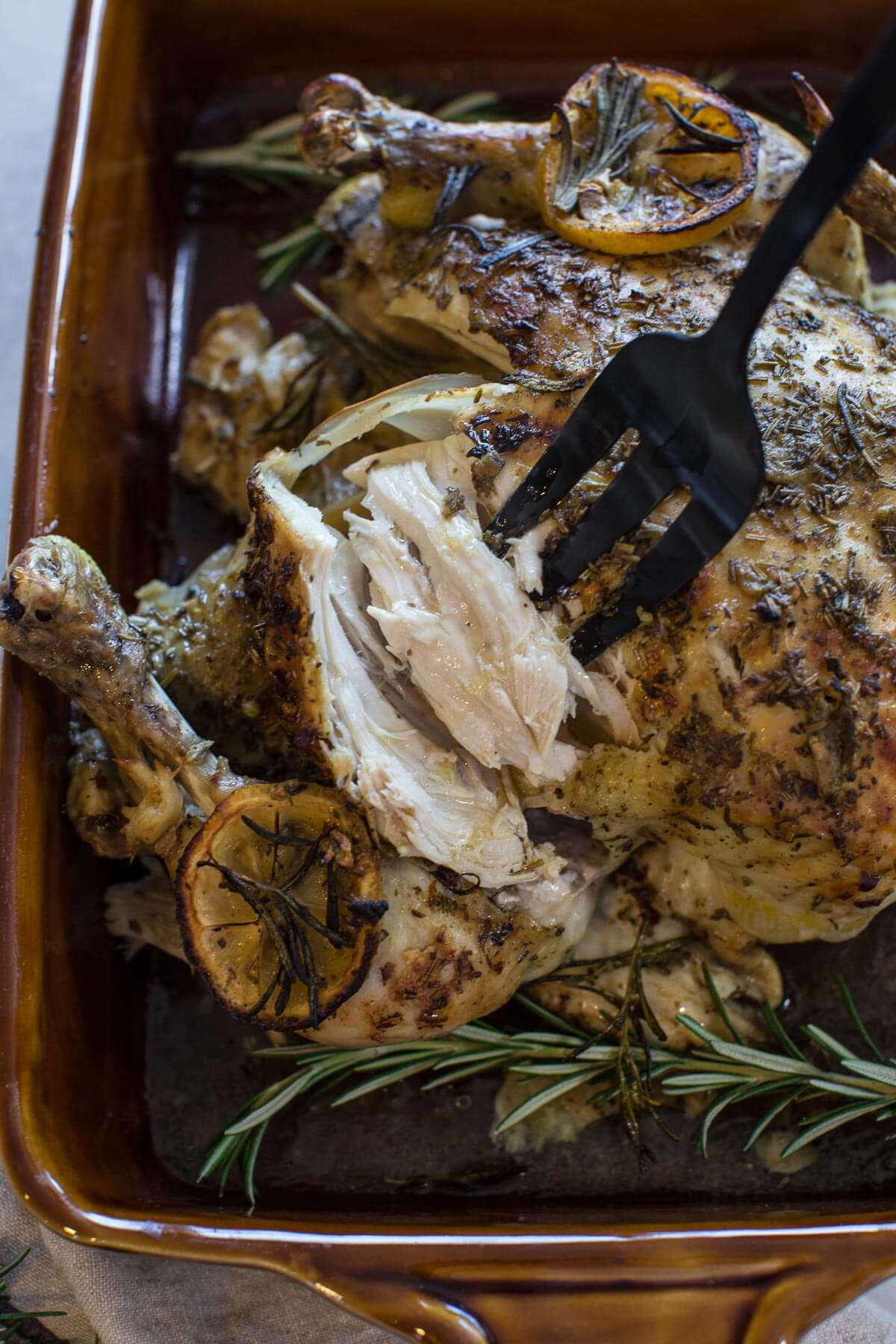 up close shot of instant pot whole chicken with fresh herbs