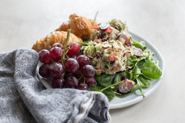Greek Yogurt Chicken Salad with grapes is life changing. Make this easy chicken salad recipe made with grapes, cranberries, and almonds for healthy lunch meal prep.