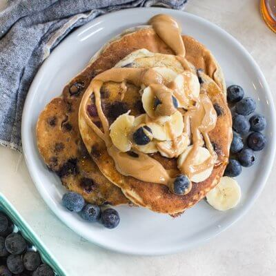 Greek yogurt pancakes recipe made with almond flour, banana and blueberries.
