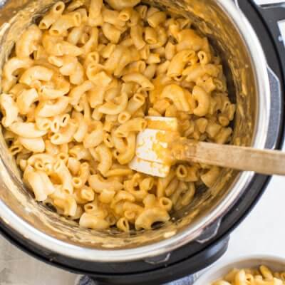 This is the best Instant Pot Mac and Cheese recipe with hidden veggies-- it's a fan favorite kid friendly meal around here. Easy homemade mac n cheese recipe ready in 5 minutes! Woot woot!
