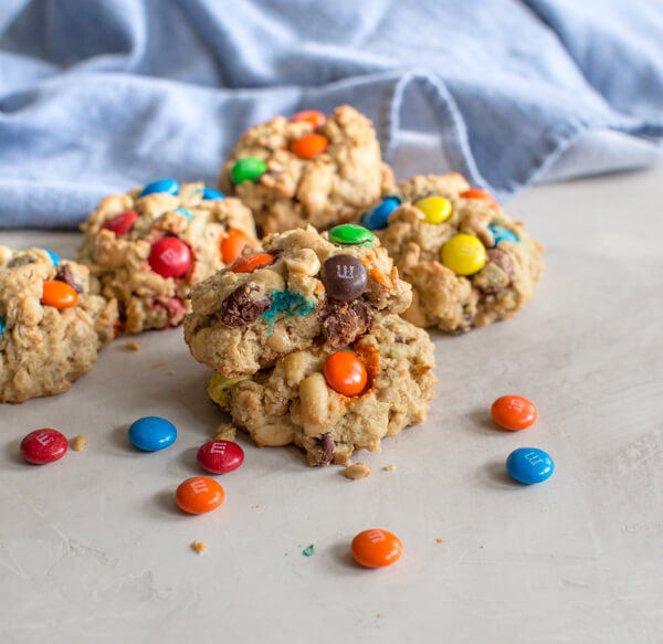 Gluten Free Monster Cookies-- a healthy peanut butter oatmeal cookie recipe with m and ms... your favorite monster trail mix in flourless cookie form.