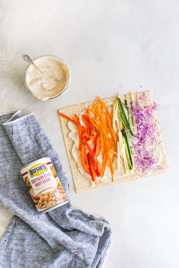 Easy pinwheel recipe for kids = Rainbow Veggie Pinwheels. A veggie loaded kid friendly lunch box recipe made with white bean hummus that encourages them to eat the rainbow. #pinwheels #veggie #rainbow #kidfriendly #lunchboxideas #healthykidrecipes