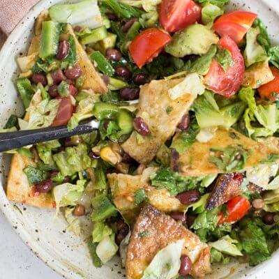 How to make Fiesta Fattoush Salad with fried flour tortillas, black beans, and homemade cilantro lime dressing. Easy weeknight dinner packed with veggies.