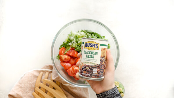 Can of BUSHS Black Bean Fiesta in Fattoush Salad Dressing