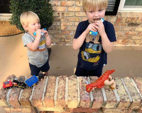 boys eating Clif Bar snacks