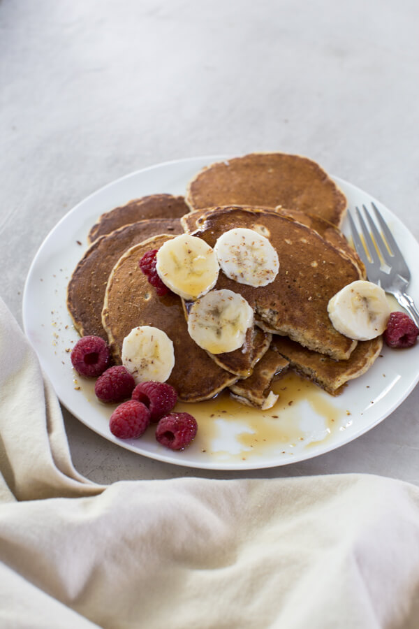 Whole Wheat Pancakes made with flaxseed and whole wheat flour and boast of fiber, protein and healthy fats.